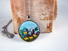 Floral meadow embroidered necklace pendant by EmbroideredJewerly