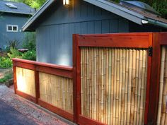 10 DIY Fence Ideas. This was the only one I really liked but it looks neat. Simple red wood and bamboo.