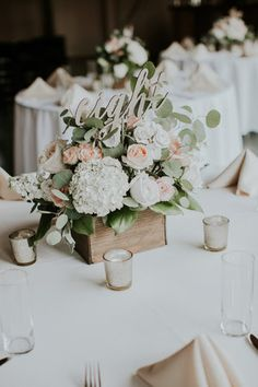 centerpieces of white hydrangea, soft petite roses, and greenery. Bridalbliss.com | Portland Wedding Planner | Oregon Event Design | Olivia Strohm Photography