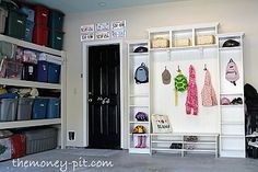 """I used Ikea bookcases and some beadboard to create a small """"mudroom"""" by the garage entry door.  Repainting the walls and doors also makes the space seem much more finished."""