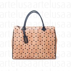 I love this cork bag!  It reminds me of the lattice seen in the Mezquita of Cordoba!