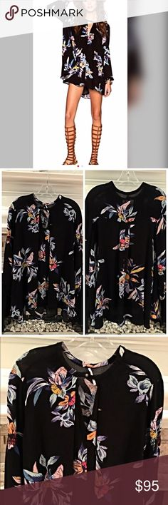 Free People out of stock amazing floral tunic! Keyhole in front stunning hi low drape in swing style- beautiful vibrant colors against jet black- Free People Tops Tunics