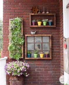 Hens and Chicks vertical planter goes KABOOM. So amazing, by Inspired by Charm