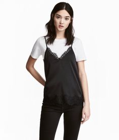 Black. V-neck camisole top in woven fabric with lace details and narrow, adjustable shoulder straps.