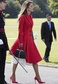 11 August 2017 - Queen Raina attends the Sovereign's Parade at Sandhurst Military Academy - coat by Givenchy, shoes by Gianvito Rossi, bag by Louis Vuitton