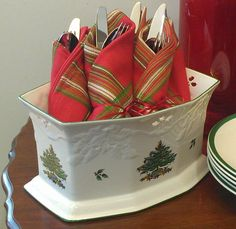 Bundle flatware and napkins for easy buffet self-service.  Use a pretty container for easy pick-up and decorative appeal.