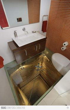 Glass-floor-toilet/bathroom/powder room in a penthouse apartment in Guadalajara, Mexico. Built over an unfinished elevator shaft that goes down 15 stories. Reinforced glass, of course. Luxury Penthouse, Glass Floor, Bathroom Toilets, Glass Bathroom, Funny Bathroom, Bathroom Art, Bathroom Vanities, Bathroom Cabinets, Master Bathroom