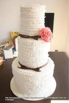 Elegant fondant Swirls with a pink rose, 3 tier wedding cake.