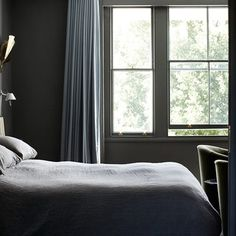 The owner of this bedroom wanted a moody feel, so designer Suzy Hoodless hung grey linen curtains with large pencil pleats from a recessed ceiling track. This keeps out the light and is neater than a pole. Try Silent Gliss for track, from £15.98 for 125cm.