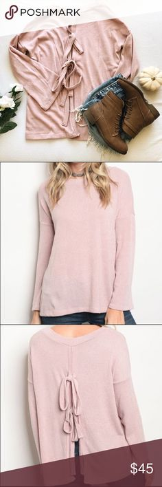 """Pink Tie Top This long sleeve pink lightweight sweater ties in the back. Pair this with jeans and booties for a must have fall look Materials: •polyester/ spandex blend Measurements: •Small = Bust 20""""/Length 36"""" •Medium= Bust 23""""/Length 26"""" •Large = Bust 24""""/Length 26"""" Sweaters Crew & Scoop Necks"""