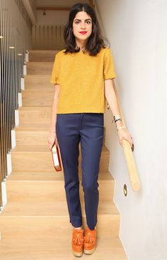Leandra Medine channels the '70s, rocking a boxy top, platform loafers, and a statement lip. Would you try this look?