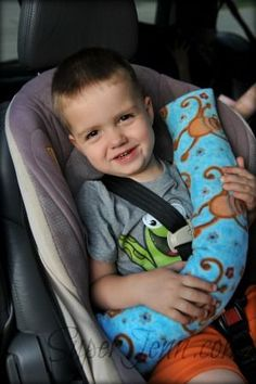 SuperBaby Pillow by Super Jenn - pillow that fits around a seat belt in a car seat