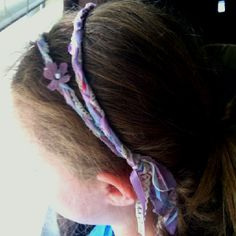 Fairy braided headband...lace, fabric and ribbon...braided with a hot loop at the ends for elasticity.  Glue flower  petals on for a whimsical look