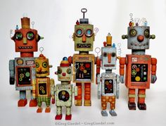 Greg Guedel vintage tin toy robot assemblages, carved wood, found objects, clear resin.