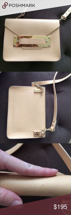 Sophie Hulme mini envelope crossbody clutch beige Few scratches to the leather, some creasing in the strap on the shoulder area. Very good condition. No dustbag. I purchased this pre owned but never used it myself. Authentic. Sophie Hulme Bags Crossbody Bags