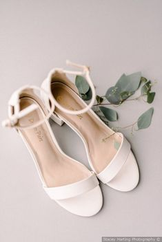 Adorable classic wedding shoe - white heel with with two straps styled with greenery {Stacey Harting Photography}