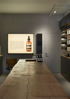 A slice of reclaimed pine, patterned by knots and cracks in the ageing wood, forms a counter top for Aesop's first South Korean flagship store by local studio Wise Architecture.