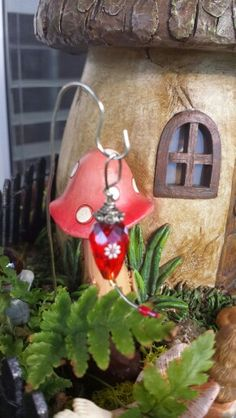 Hummingbird feeder made with a bead.
