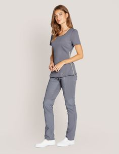 Chiffon Zipper Top in Graphite is a contemporary addition to women's medical scrub outfits. Shop Jaanuu for scrubs, lab coats and other medical apparel. Spa Uniform, Scrubs Uniform, Dental Uniforms, Nurse Uniforms, Scrub Suit Design, Scrubs Outfit, Corporate Wear, Professional Wardrobe, Medical Scrubs