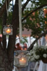 Southern vintage candle lights from a tree...I love it!