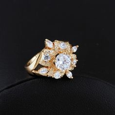 $2.67  Fashion Flower Shape Inlay Zircon 18K Gold Plated Copper Finger Ring Full Sizes http://www.eozy.com/fashion-flower-shape-inlay-zircon-18k-gold-plated-copper-finger-ring-full-sizes.html