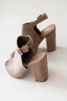 Taupe heels with a soft faux suede texture. Peep toe and an adjustable ankle…