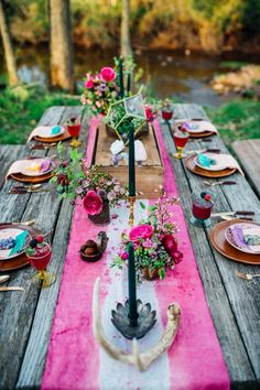 Colorful rustic wedding reception spread with flowers and gemstone accents