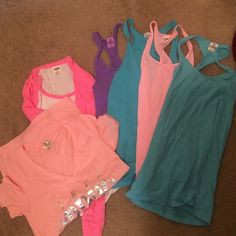 Victoria's Secret Collection All size small, in good condition slightly to never worn! 4 tank tops, 1 tee shirt, and 1 long sleeve shirt! PINK Victoria's Secret Tops Tank Tops
