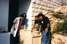 A crate filled with Holocaust victims'shoes, arriving at Yad Vashem from the Majdanek death camp in preparation for exhibition in the Holocaust History Museum in Yad Vashem. Left to right: Haviva Peled-Carmeli, Director of the Artifacts Department; Yehudit Inbar, Director of the Museums Division