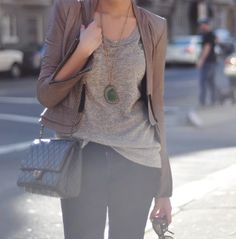 Slightly dress up a casual outfit with a blazer and a pendant.