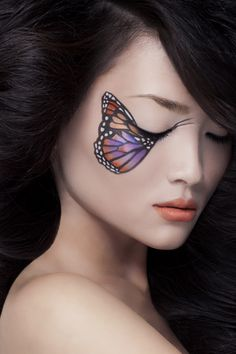 butterfly for the eyes makeup again. Love her expression, some sort of pain or longing...
