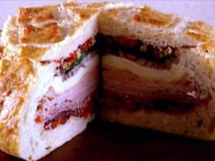 Yummy Muffuletta Sandwiches : Make mile-high muffuletta sandwiches stuffed with cured meats and olives. Soup And Sandwich, Sandwich Recipes, Meat Recipes, Gourmet Recipes, Cooking Recipes, Muffuletta Recipe, Muffuletta Sandwich, Slider Sandwiches, Sliders