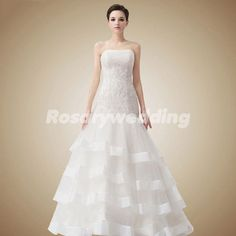 Beading aplliques strapless tiered organza wedding dress. $289.00, via Etsy.