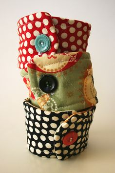 coffee cup cozies. Need to make one of these for E's sippy cup - she doesn't like getting her fingers wet from condensation.