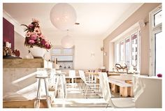 Miss Lilly's restaurant bar café, Munich, Germany, cosy beautiful, delicious cakes, bright light interior, cozy lounge corner, mainly organic food, coffee, homemade cake and quiche also to go, Written by Sarah Antwerpes