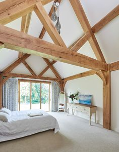Since 1980 Border Oak have specialised in the design and construction of exceptional bespoke oak framed buildings across the UK and abroad Barn Bedrooms, Oak Bedroom, Bedroom Loft, Master Bedroom, Vaulted Ceiling Bedroom, Vaulted Ceilings, Oak Framed Extensions, Exposed Trusses, Border Oak