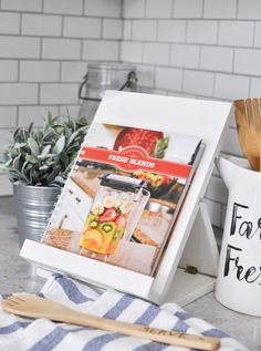 We are back visiting over at Cherished Bliss because there is a great DIY for a Foldable Recipe Stand with Free Plans. This is such a fantastic piece to have and oh so useful! You can use it for Cookbooks or a Tablet. Paint it a distressed white…stain it or give it any paint treatment …