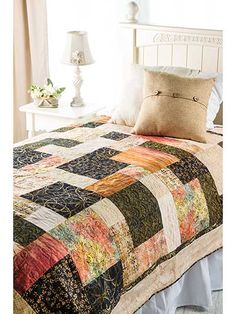 """Use a fat quarter collection to make this fast and easy quilt in a weekend. You won't believe how quickly it goes together. This e-pattern was originally published in the Spring 2014 issue of  Quilter's World  magazine. Finished size is 71 1/2"""" ..."""