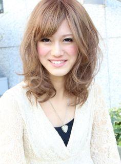 Medium hair cut Light brown color