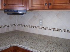 A mosaic that POPS! Davinci Mosaic w/Tumbled Durango and Sandgate Switchplate from BEST Tile. www.BestTile.com