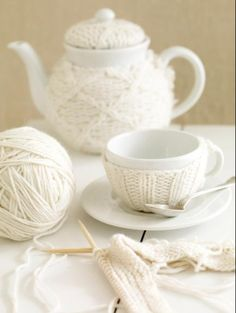 Such a cute idea, knitted teacup and pot cosies <3