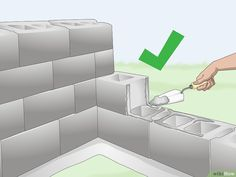 How to Build a Cinder Block Wall. Whether you're building a retaining wall or just need some extra privacy, a cinder block wall is an affordable way to get the job done. Once you've got your base set up, it just takes some finesse in… Concrete Block Retaining Wall, Small Retaining Wall, Building A Retaining Wall, Concrete Block Walls, Garden Retaining Wall, Building A Fence, Concrete Patio, Concrete Wall, Cinderblock Fence