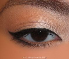 day time cat eye look. this site has a ton of tips trick and different looks. step by step instructions too!!!