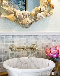 Wall Mount facet into stone bowl  Designer Bathrooms and Pictures - Bathroom Decorating Ideas - House Beautiful