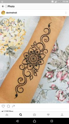 Mehndi design. Again, not too keen on the flower. Swirls are great.