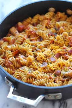 One Pot BBQ Chicken Pasta - Loaded with tangy BBQ sauce and crisp bacon. It's so easy, even the pasta gets cooked right in the pot! chicken dinner One Pot BBQ Chicken Pasta Pasta Recipes, Dinner Recipes, Cooking Recipes, Dinner Ideas, Meat Recipes, Pasta Meals, Recipies, Dessert Recipes, Pasta Dishes