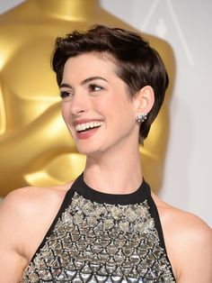 How Many Ways Can Anne Hathaway Style Her Pixie Cut?: The bob might be the current It hairstyle, but lately we've noticed all the amazing things Anne Hathaway has been doing with her pixie cut. Short Pixie Haircuts, Pixie Hairstyles, Short Hairstyles For Women, Short Hair Cuts, Cool Hairstyles, Pixie Cuts, Pixie Bangs, Pixie Cut Back, Wavy Pixie