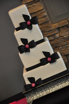 Damask with black & pink bows wedding cake