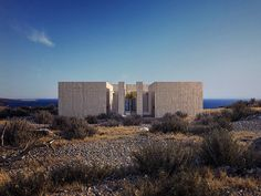 kapsimalis sets two brutalist holiday houses on the edge of santorini's cliffs