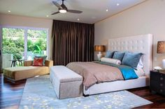 Clean, modern master bedroom, with upholstered headboard.
